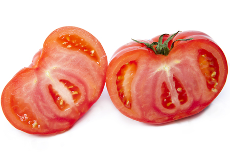 Two half of the cut tomato Imagens