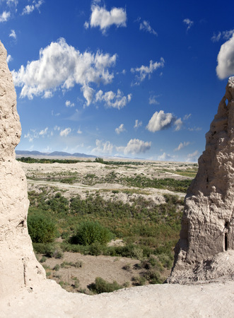 View from a breach in a wall of ancient fortress Kyzyl-kala on the Kyzylkum Desert