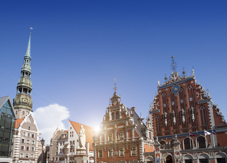central Riga square with house of Blackheads and st peter's cathedral, Latvia Stock Photo