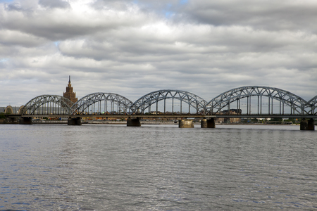 View on Railway Bridge over Daugava River and the building of the Academy of Sciences in Riga, Latvia