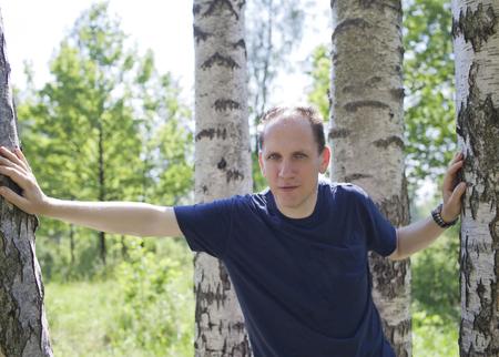 man near a birch in sunny day Stock fotó