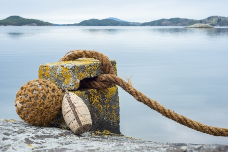 the mooring: Mooring with coastline in the background Stock Photo