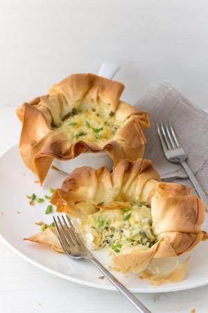 filo: Onion mini tarts of filo pastry with cheese Stock Photo