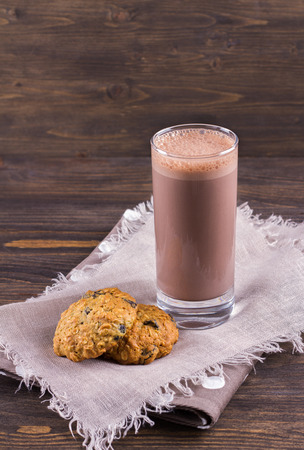 milk and cookies: Chocolate milk with diet oatmeal cookies Stock Photo