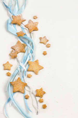 sugar cookie: Christmas stars cookies with powder sugar on white textile background Stock Photo