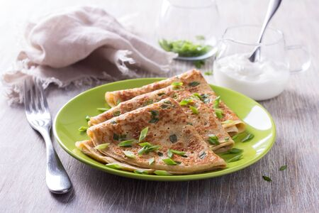 green onions: Pancakes with green onions and sour cream