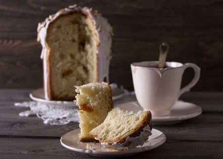 paskha: Traditional easter cake, kulich, on the wooden table in rustic style