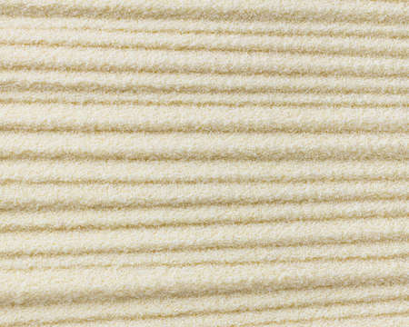 Raw dried semolina background, texture, horizontal grooves, top view