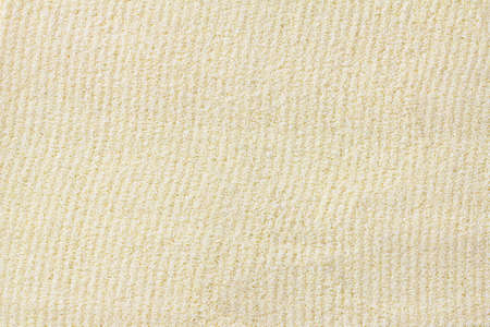 Raw dried semolina background, texture, vertical grooves, top view