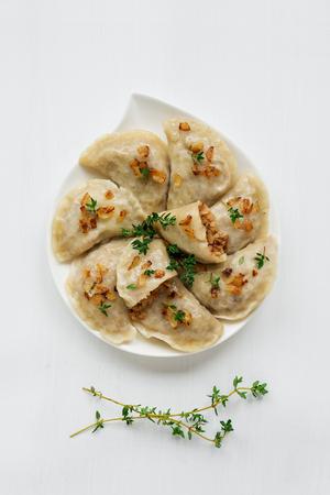 Dumplings with buckwheat porridge and fried onions.