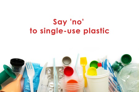 White single-use plastic and other plastic items on a white background