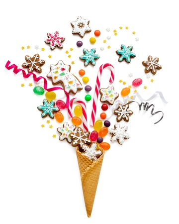 Ice cream cone with fireworks of Christmas sweets and decorations