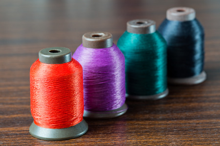 colored thread on the table