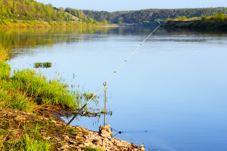 fishing rod on the river photo