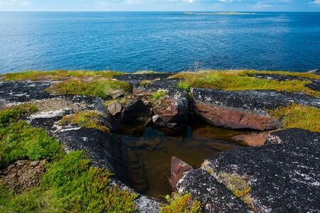 arctic waters: Puddle on the rock. Sea View Stock Photo