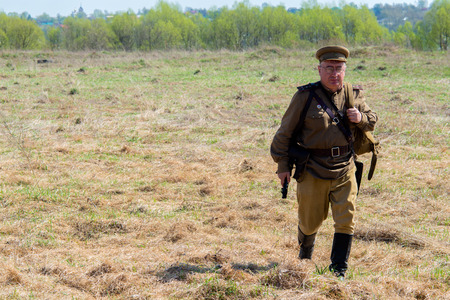 STUPINO, RUSSIA - APRIL 30,2017: A man in uniform with a rifle in his hands. Victory. Military reconstruction of the Second World War in Stupino. Russia.