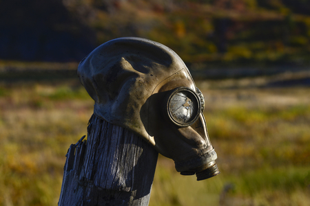 Gas mask on the pole in autumn Stock Photo