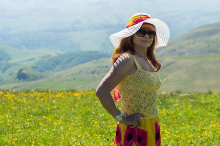 Woman in hat on a sunny day outdoors Stock Photo