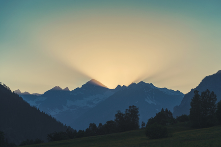 Beautiful sunrise in the morning clear sky with rays and mountain silhouette 版權商用圖片