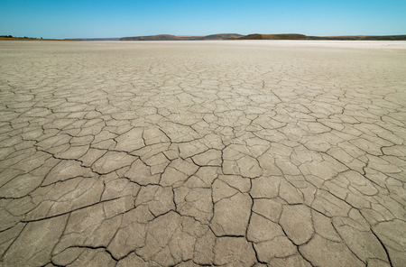 Dry cracked earth. The desert. Background. Archivio Fotografico - 115008290