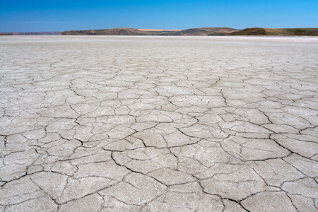 Dry cracked earth. The desert. Background. Archivio Fotografico - 115008335