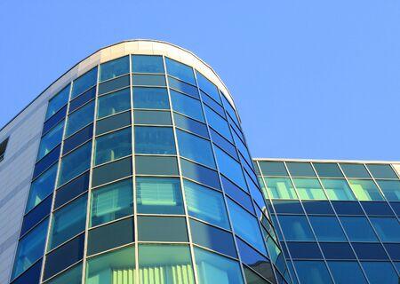 Facade of office building on a background lightblue sky