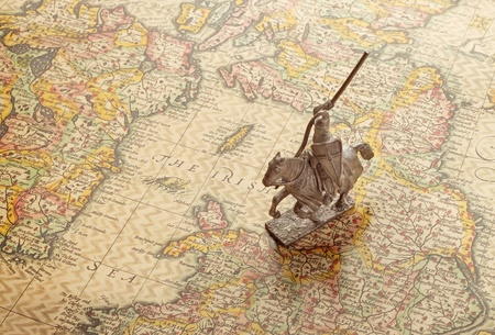 model of medieval knight on an age-old map Stock Photo