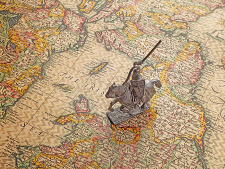 model of medieval knight on an age-old map photo