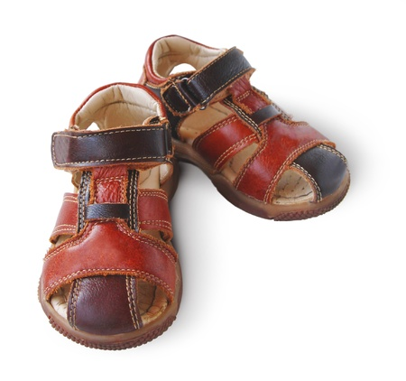 Pair of childs summer sandals it is isolated on a white background photo