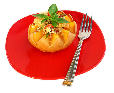 pips: Baked pumpkin with rice, on a red dish it is isolated a bow, garlic and pips Stock Photo