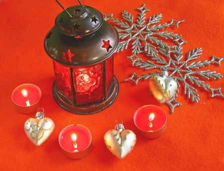 Red lantern with candles on a red background photo