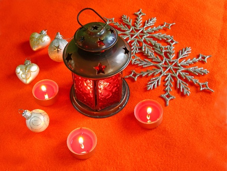 Red lantern with candles on a red background Stock Photo - 12686359