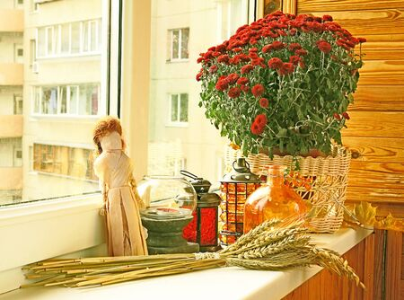 Creation of autumn mood on a balcony by candlesticks photo