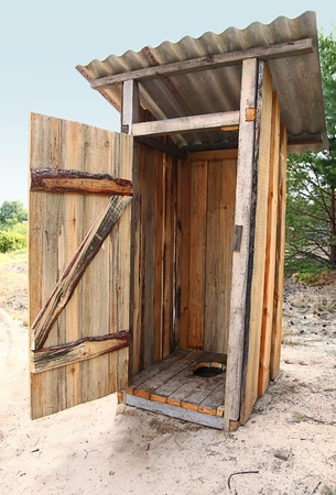 tradtional wooden outside toilet with the opened door Stock Photo
