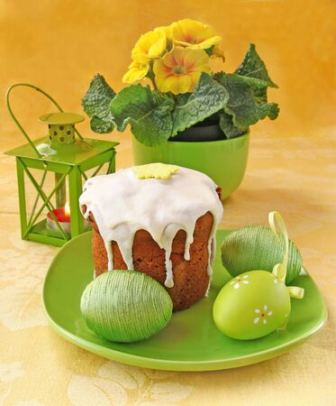 conflagrant: Traditional easter cake with eggs and green flashlight with a conflagrant candle Stock Photo