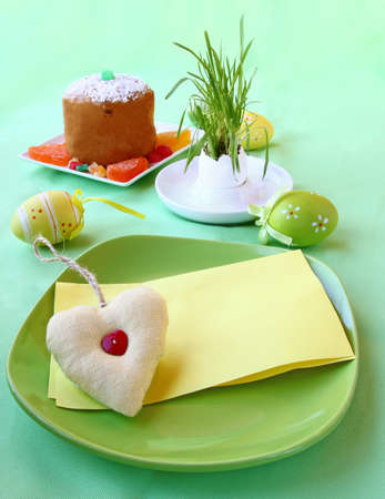 consuetude: Holiday decoration of the Easter table with a thin captain by a young rabbit and card for a guest Stock Photo