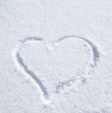 heart on the snow for the valentines day photo