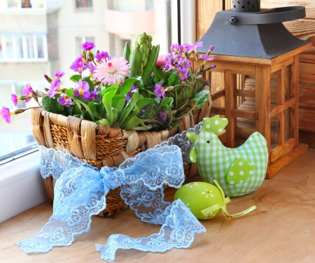 easter decorating of window by a Easter egg and spring flowers