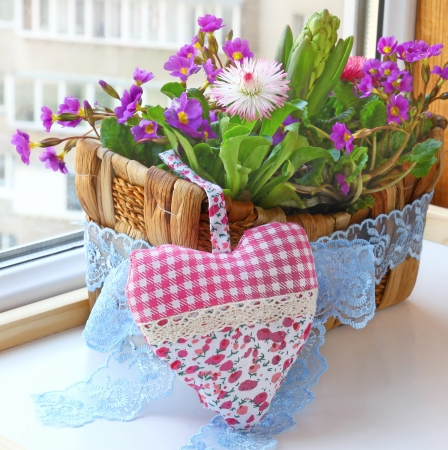 Decoration floral composition in a small basket f hyacinths bellis and primrose Spring flowers on a balcony photo
