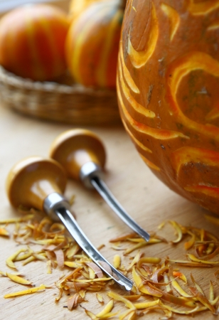 Excision of patterns on a pumpkin. Creation to halloween. Stock Photo - 15911857