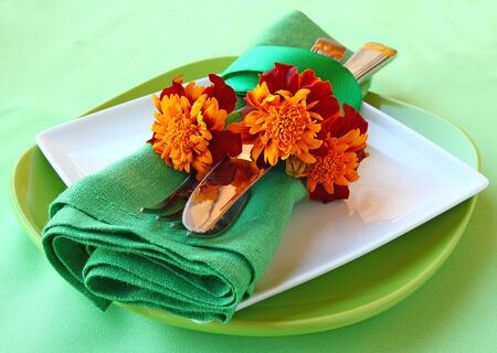 Serving of holiday autumn table with marigolds