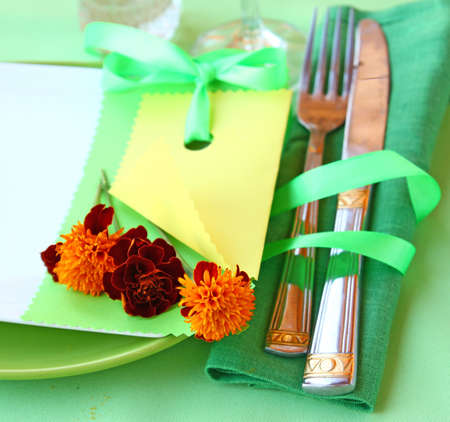 Serving of holiday autumn table with clean guest card and marigolds photo