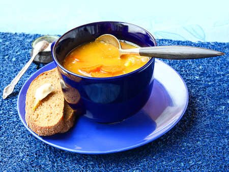 ingest: Dinner from pumpkin soup and slice of bread with the lobule of garlic