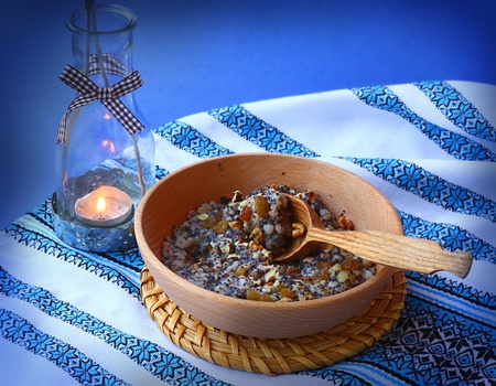 christmas eve: Sacral lean porridge from a wheat, poppy, nuts and honey, which is cooking in eve Christmas Stock Photo
