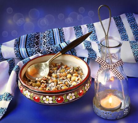 consuetude: Traditional meal in eve Christmas Kutya on a background a lantern Stock Photo