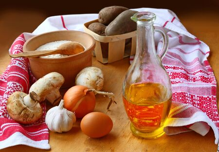 consuetude: Ingredients for cooking of traditional food of the Ukrainian kitchen of dumplings Stock Photo