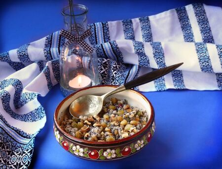 consuetude: Traditional meal in eve Christmas  Kutya  on a background a lantern
