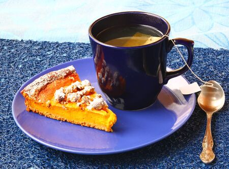 Morning breakfast with pumpkin pie and  cup of green tea Stock Photo - 18412677