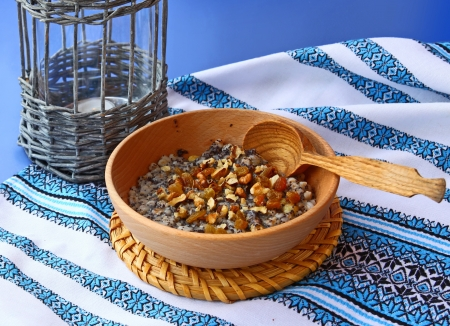consuetude: Sacral lean porridge from a wheat, poppy, nuts and honey, which is cooking in eve Christmas Stock Photo