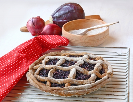 French meatless pie made from rye flour and stuffed with red cabbage and onions photo
